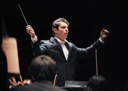 Male music student conducting