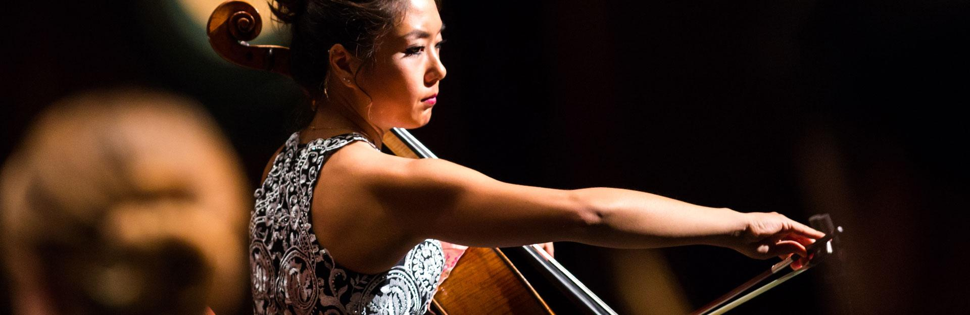 Student cellist performing with the ASU Symphony Orchestra
