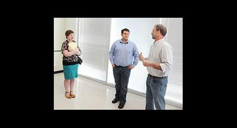 Three people conversing in a room