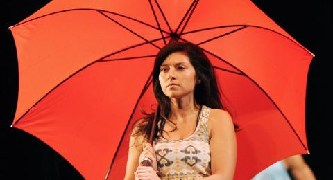 The Hour - Woman with red umbrella.