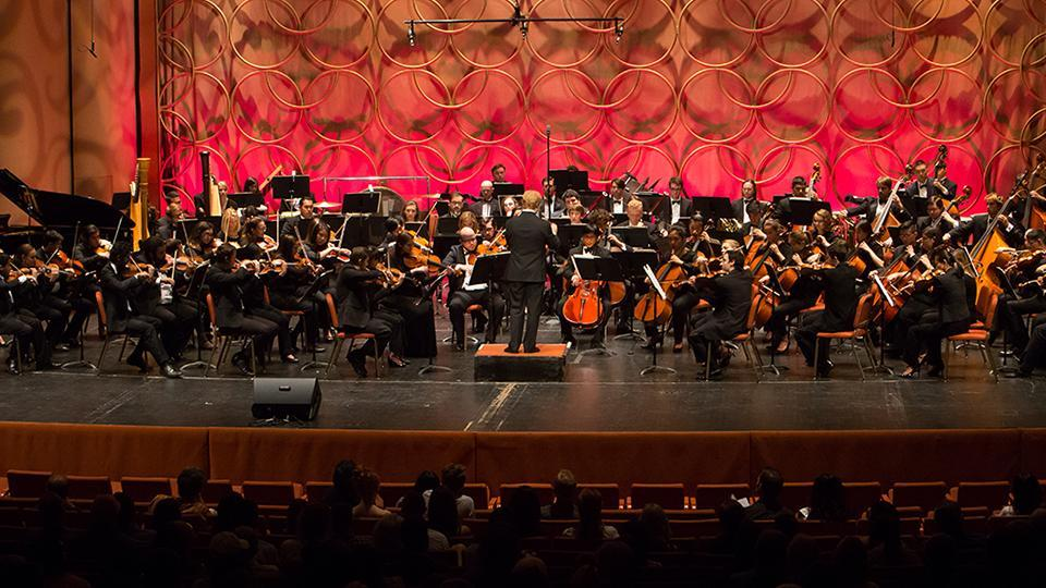 An orchestra playing on stage