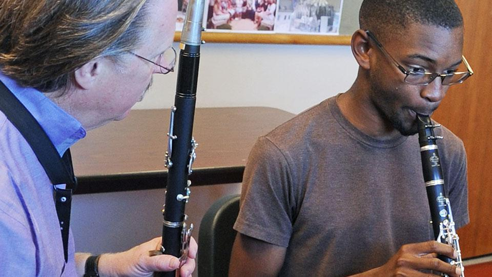 ASU music student learning clarinet in personal lessons with Professor Spring.