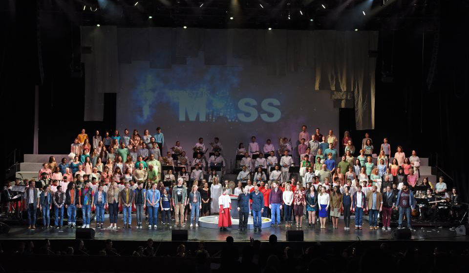 Many people standing on a stage.