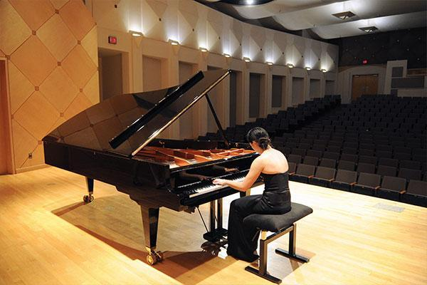 student performing on piano